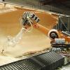 用六轴库卡机器人实现大规格工程设计板件的铣削自动化
