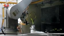 泰达机器人喷涂羽毛球拍