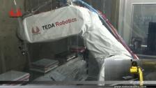 泰达机器人喷涂汽车感应器
